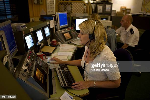 Controller working in the control room at the Charing Cross police station watches CCTV footage from screens across central London and communicates...
