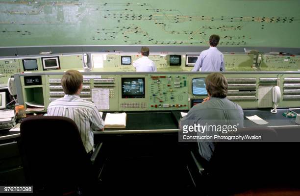 Controllers follow the progress of trains at the control centre at Victoria in London circa 1993 United Kingdom