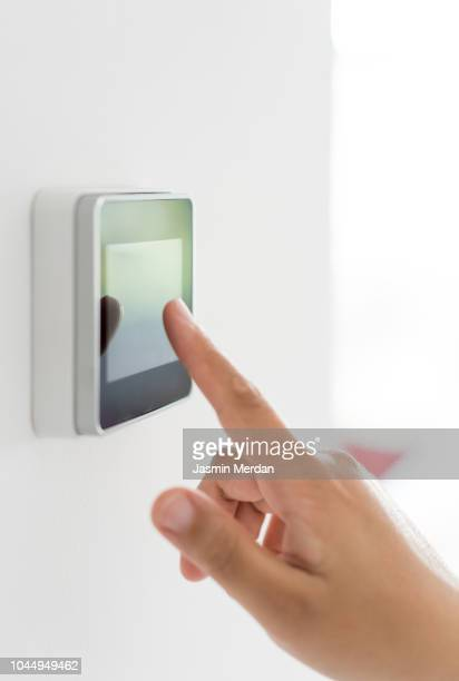 controlling smart home device - home icon stock photos and pictures