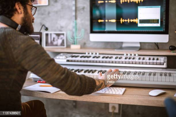 controlling the quality of the sound - producer stock pictures, royalty-free photos & images