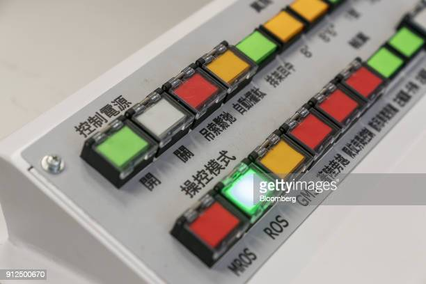Controls are seen in an operation room for remotecontrolled cranes in Container Terminal 9 operated by Hong Kong International Terminal a unit of CK...