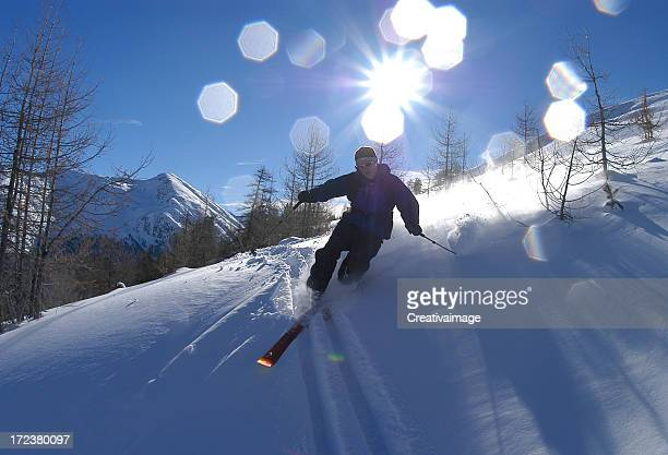 Controluce con riflessi sciatore