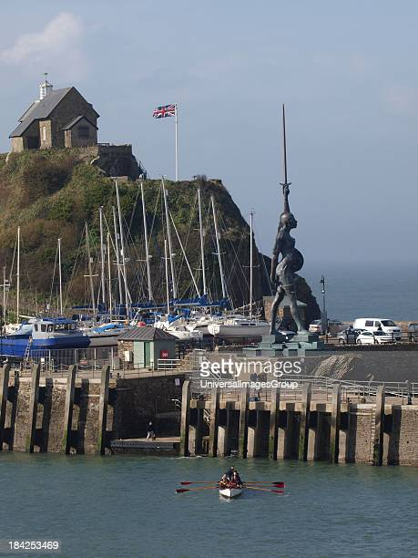 A controversial 66ft statue of a pregnant woman by artist Damien Hirst Ilfracombe Devon UK