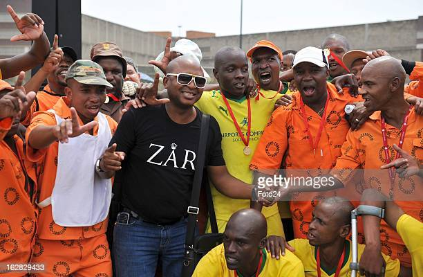 Controversial businessman Kenny Kunene celebrates with the winning soccer team at Johannesburg Central Prison on March 10 2011in Johannesburg South...