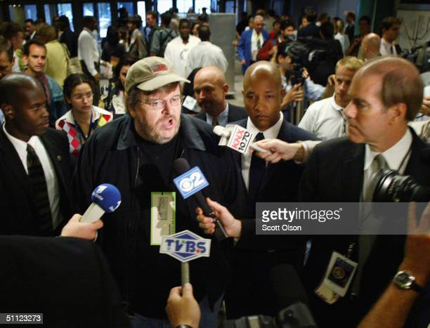 Controversial filmmaker Michael Moore speaks to reporters during the Democratic Convention July 28 2004 at the FleetCenter in Boston Massachusetts...