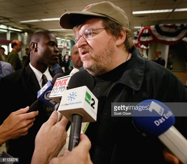 Controversial filmmaker Michael Moore speaks to reporters during the Democratic Convention July 28, 2004 at the FleetCenter in Boston, Massachusetts....