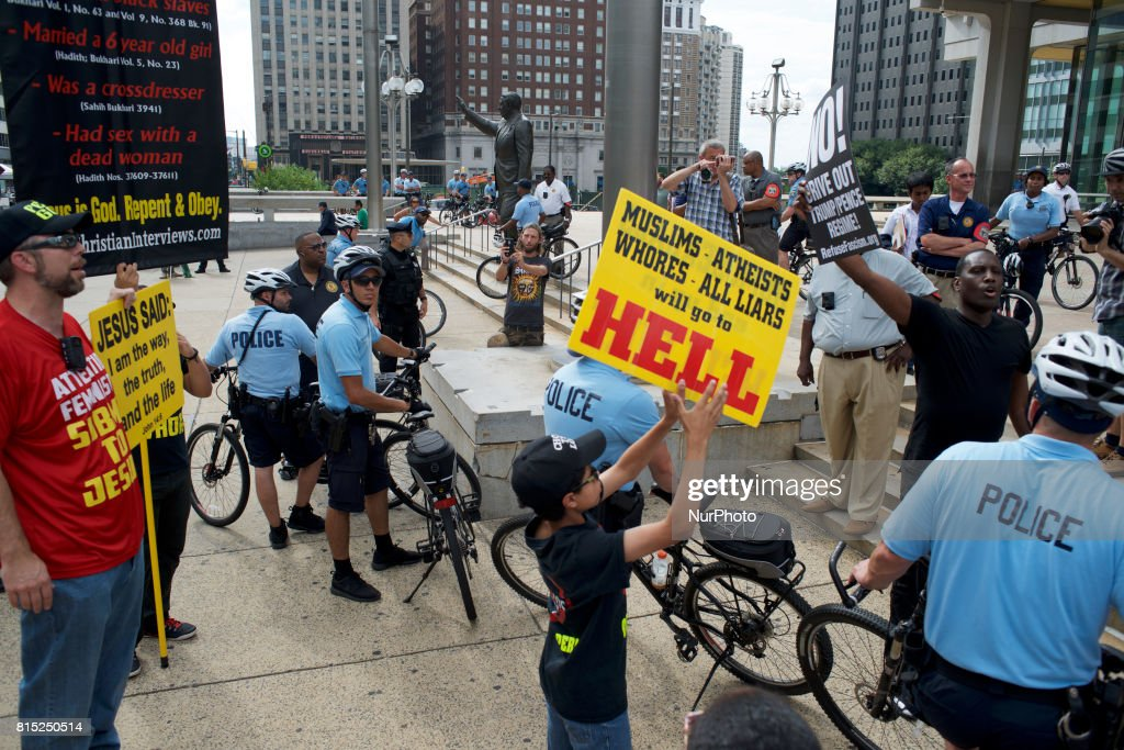 Controversial religion group led by 'Pastor Aden' holds a counter protest on the sidelines of a Anti-Trump Refuse Racism rally, in Philadelphia, Pennsylvania, on July 15, 2017.