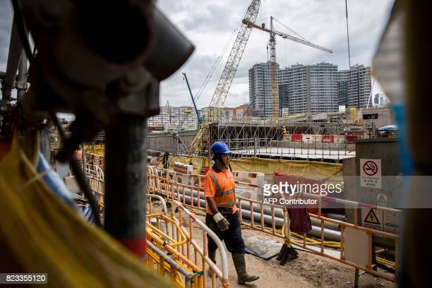 A contruction worker walks in the construction site for the West Kowloon terminus of the highspeed rail link connecting Hong Kong to the southern...