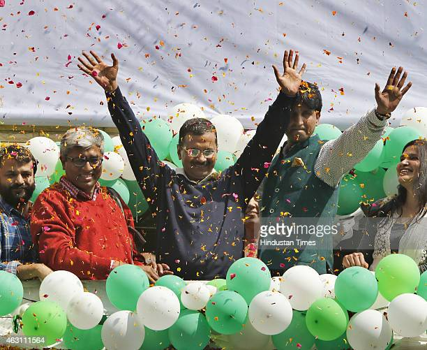 AAP convener and chief ministerial candidate Arvind Kejriwal along with party leader Kumar Vishwas Ashutosh Ashish Khetan Sanjay Singh raise hands in...