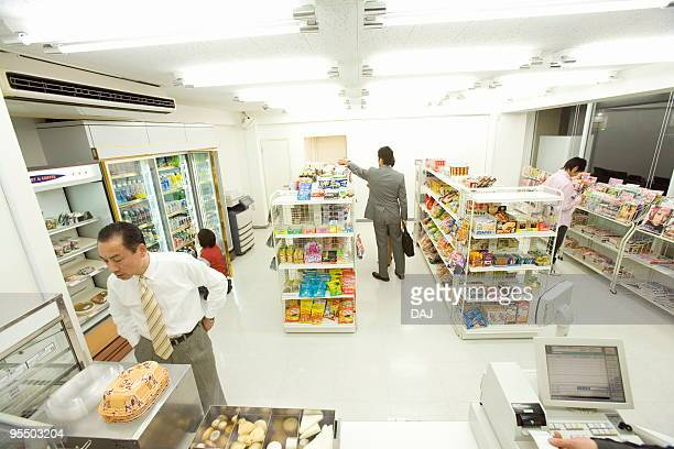 convenience store and customers - convenience store interior stock photos and pictures
