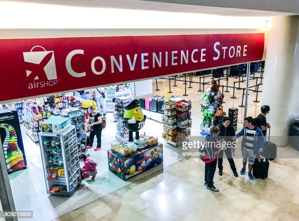 convenience store at cancun international airport, mexico - convenience store interior stock photos and pictures
