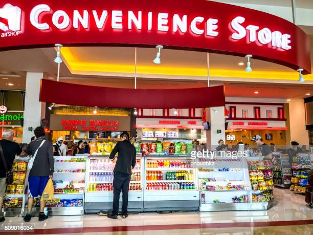 convenience store at cancun international airport, mexico - convenience store stock photos and pictures