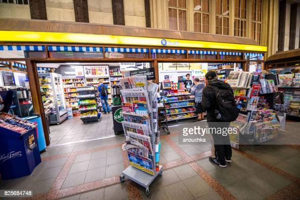 convenience store at helsinki central railway station, finland - convenience store stock photos and pictures