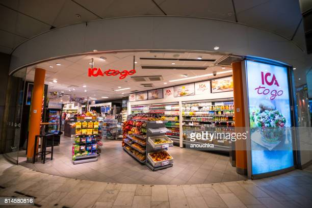 convenience store inside stockholm central station, sweden - convenience store stock photos and pictures
