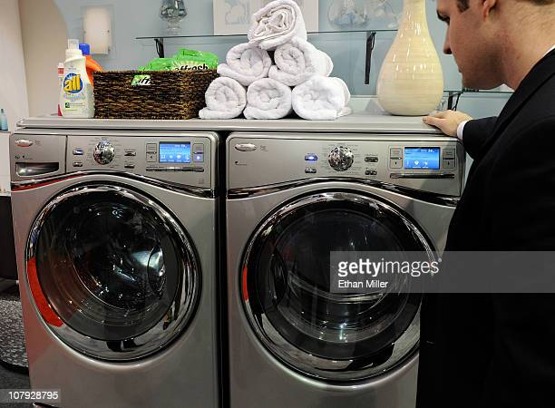 Convention attendee looks at the new Whirlpool Duet programmable washing machine and dryer at the 2011 International Consumer Electronics Show at the...