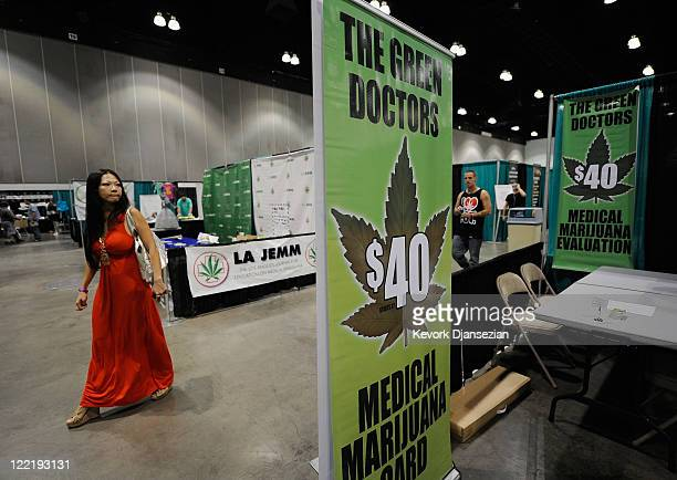 A convention attendee passes in front of a medical marijuana evaluation booth during the HempCon 2011 Medical Marijuana Expo at the Los Angeles...