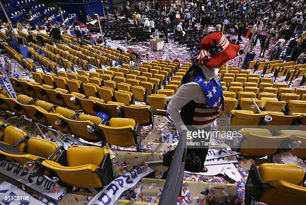 Convention delegates exit the FleetCenter amidst piles of confetti and discarded placards at last night of the Democratic National Convention July 29...