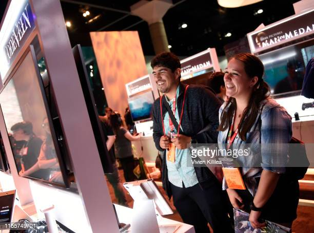 Convention goers attend E3 2019 at the Los Angeles Convention center on June 13 2019 in Los Angeles California