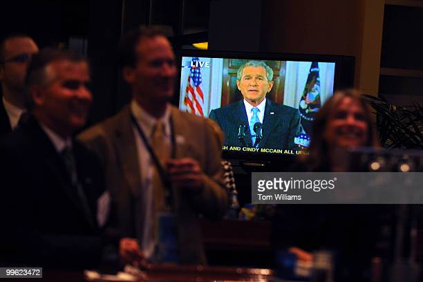 Convention goers in a private party watch President George W Bush address the crowd via satellite on second night of the Republican National...
