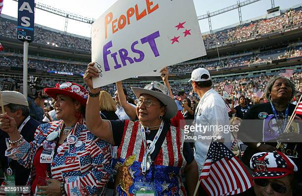 Convention goers watch the proceedings on day four of the Democratic National Convention at Invesco Field at Mile High August 28, 2008 in Denver,...