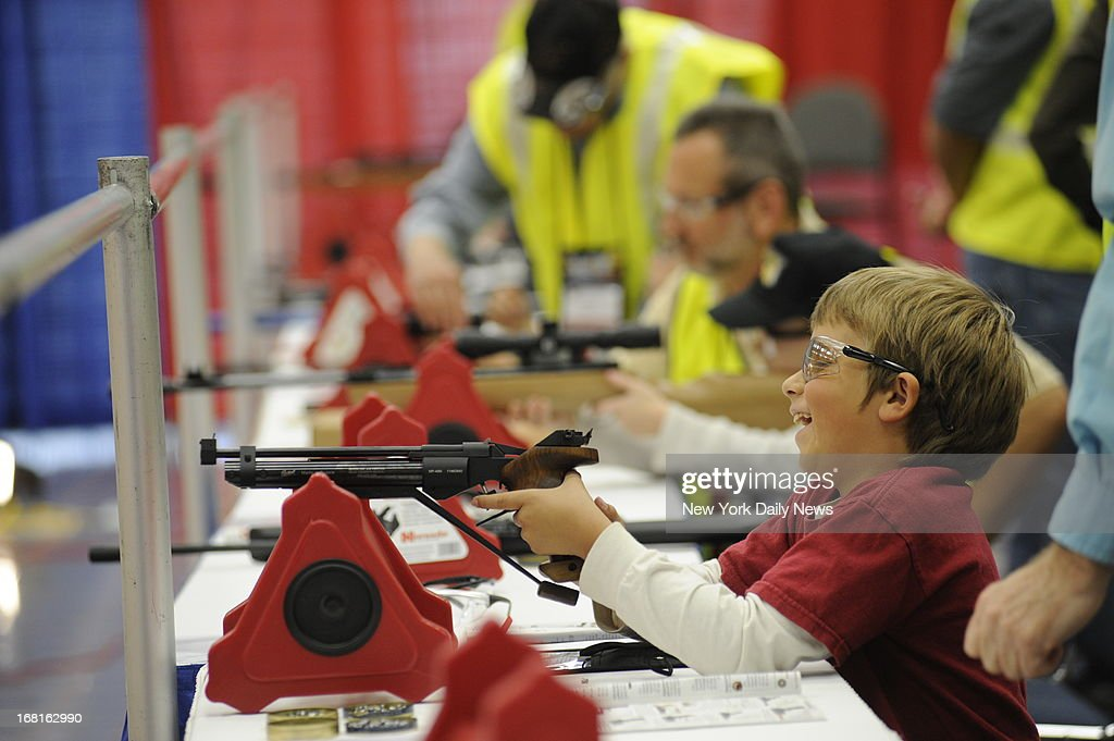 NRA Convention in Houston, Texas. Will Ayers, 7, of Valley View, Texas shooting an airsoft gun at the NRA Convention in Houston, Texas.