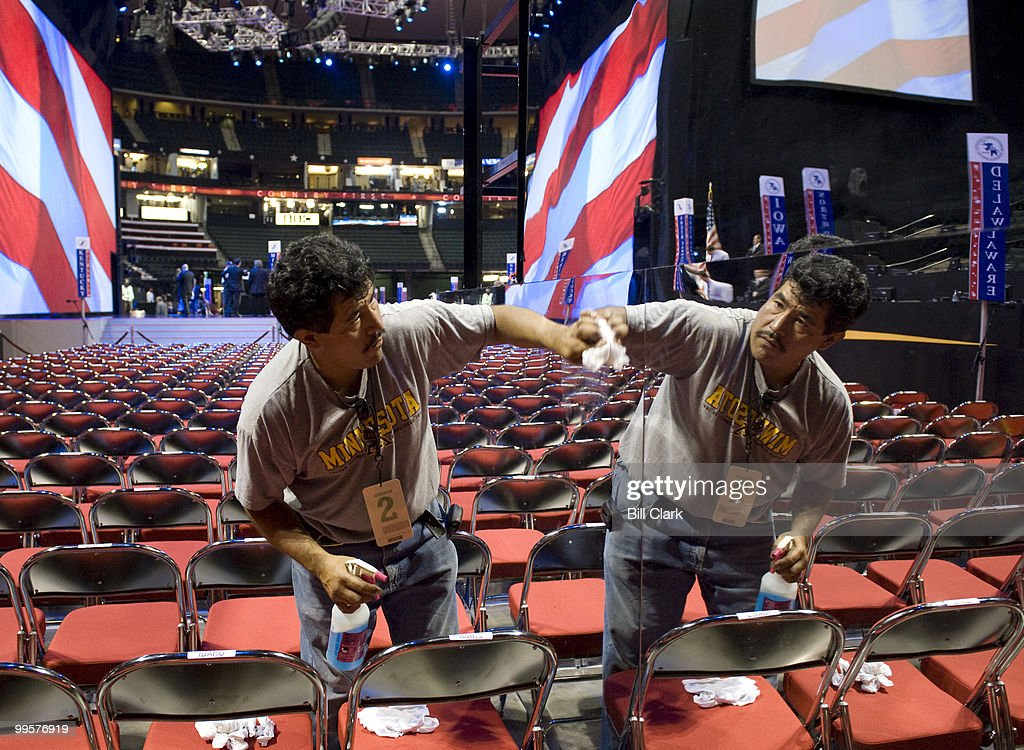 Convention worker Hector Garcia cleans the mirror sidings on one of the camera stands on the floor of the Republican National Convention at the Xcel Center in St. Paul, Minn., on Tuesday, Sept. 2, 2008.