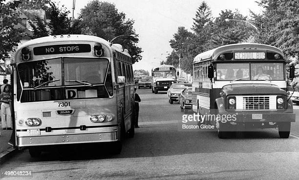 Conventional buses right and MBTA buses left on Centre Street in West Roxbury in Boston on Sept 13 1974 The front bus is equipped with flashers the...