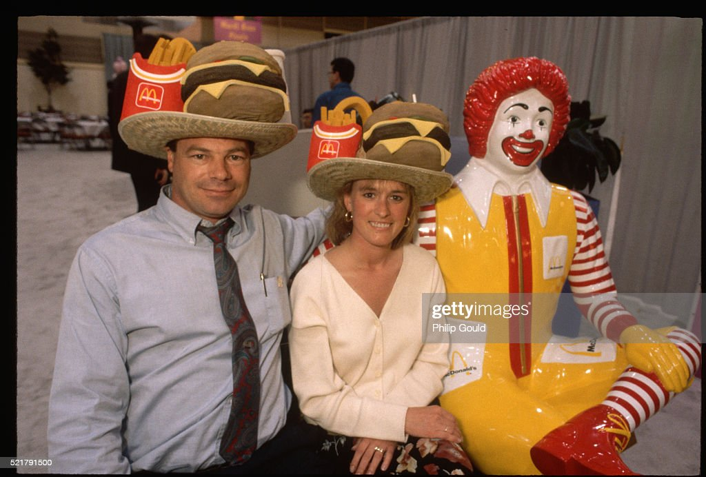 Conventioneers Sit by Ronald McDonald Statue : Stock Photo