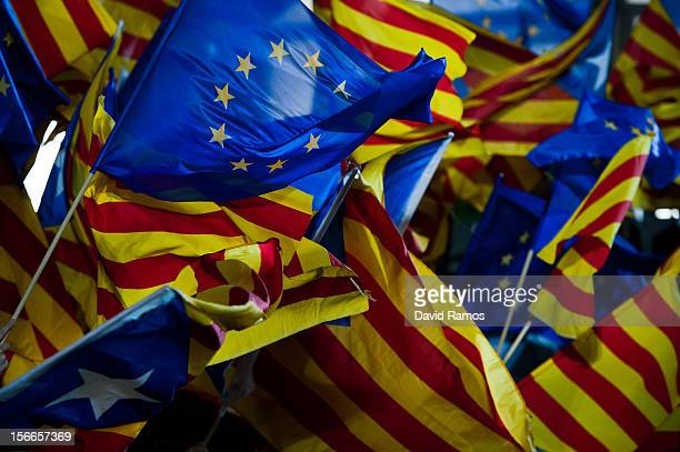 Convergencia i Unio supporters fly a Catalonia ProIndependence Catalan and European flags during the main Convergencia i Unio campaing meeting at the...