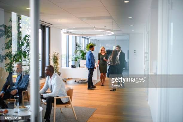 conversation groups on break from corporate business seminar - employee engagement stock pictures, royalty-free photos & images
