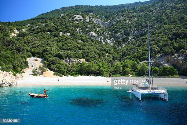conversation on paradise beach - catamaran stock photos and pictures