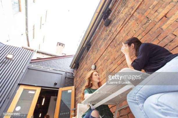 conversation - lianne loach stock pictures, royalty-free photos & images