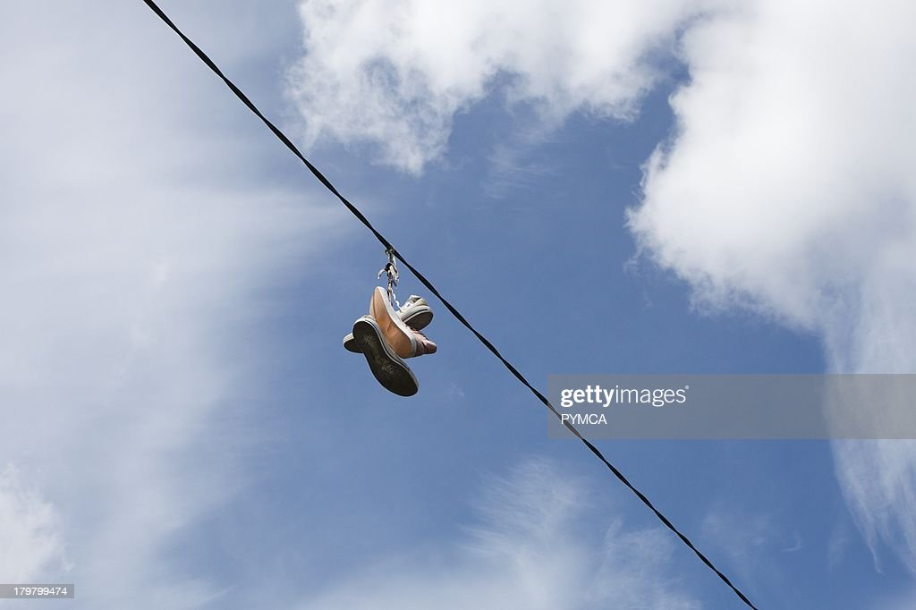 Converse All Star boots hanging on telephone wire. Pictures | Getty ...