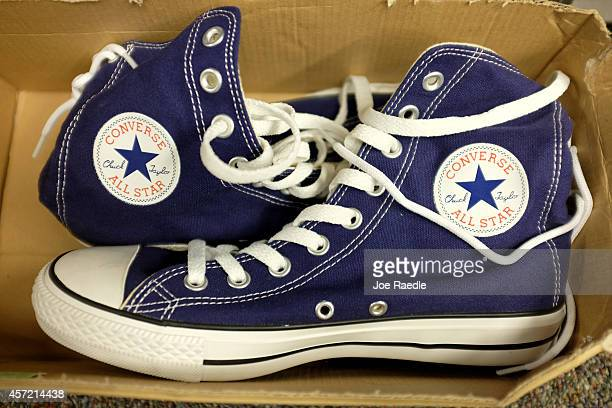 Converse shoes are seen in a store on October 14 2014 in Miami Florida Converse owned by Nike announced it is filing lawsuits against 31 companies...