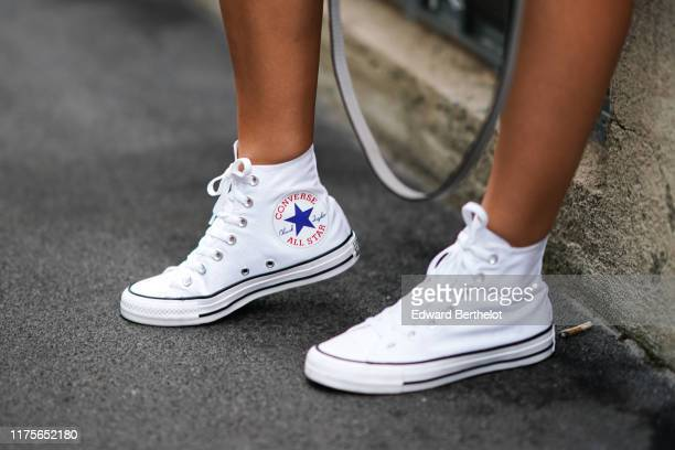 Converse sneakers are seen, outside the Prada show during Milan Fashion Week Spring/Summer 2020 on September 18, 2019 in Milan, Italy.