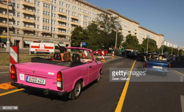 Converted Trabant cars operated by Trabi Safari drive on a tour through East Berlin on September 1 2009 in Berlin Germany Trabi Safari takes tourists...