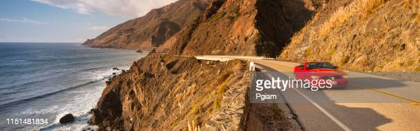 convertible car journeys down the big sur coast panorama in california usa - big sur stock photos and pictures