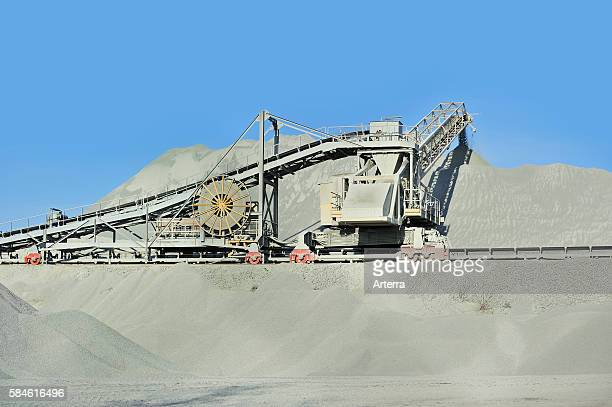 Conveyer belt at porphyry quarry openpit mine for the production of gravel for road building at Lessen / Lessines Belgium