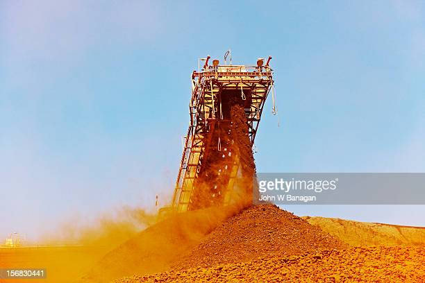 conveyor belt at an iron ore mine, australia - iron ore stock photos and pictures