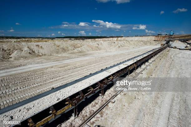Conveyor Belt At Mining Industry On Sunny Day