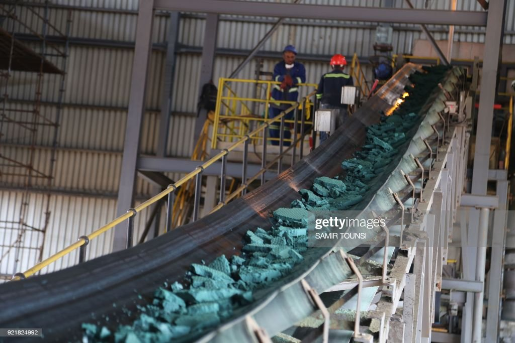 A conveyor belt carries chunks of Raw cobalt after a first transformation at a plant in Lubumbashi on February 16, 2018, before being exported, mainly to China, to be refined. To Promulgate or not to promulgate? Congolese President Joseph Kabila is playing with the nerves of markets and lobbies by continuing the suspense around the reform of the mining code which plans to multiply by five a tax on cobalt. The Democratic republic of Congo is the leading cobalt producer providing 67% of the increasing global demand. /