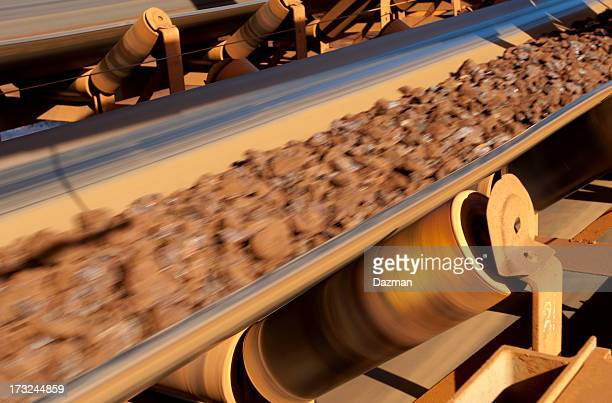 Conveyor belt carrying ore at a minesite.