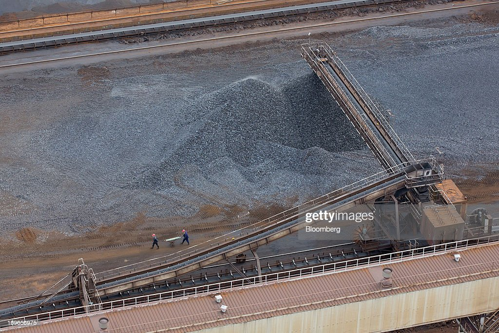A conveyor belt drops hot briquetted iron (HBI) into storage piles at the Lebedinsky GOK (LGOK) iron ore mining and processing plant, operated by Metalloinvest Holding Co., in Gubkin, Russia, on Tuesday, May 28, 2013. Lebedinsky, Russia's third biggest iron ore mine, is owned 81 percent owned by Russian billionaire Alisher Usmanov, who also owns Mikhailovsky GOK, Russia's second-biggest iron ore mine, and Oskol Electrometallurgical Combine, a steel plant supplied by Lebedinsky. Photographer: Andrey Rudakov/Bloomberg via Getty Images