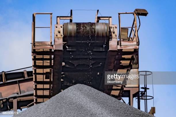 A conveyor belt drops iron ore pellets onto an outdoor storage pile at the Yeristovo and Poltava iron ore mine operated by Ferrexpo Poltava Mining...