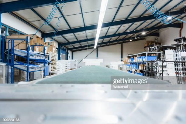 Conveyor belt in a shop floor of a company