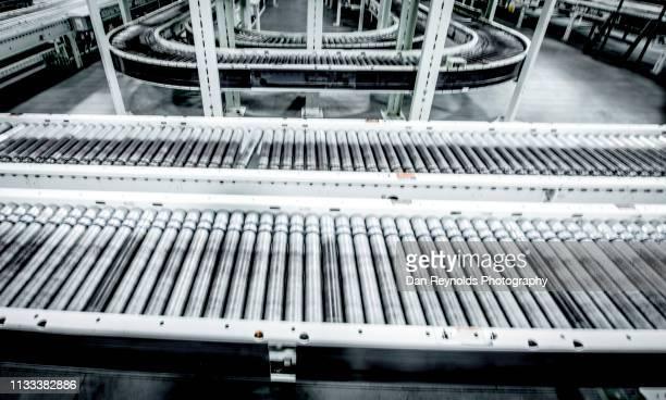 conveyor belt in factory - conveyor belt stock pictures, royalty-free photos & images
