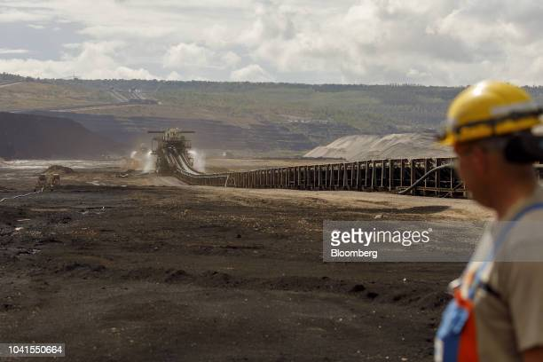 A conveyor belt stands at the open pit lignite mine operated by RWE AG in Hambach Germany on Monday Aug 13 2018 Not far from Germanys Rhine River a...