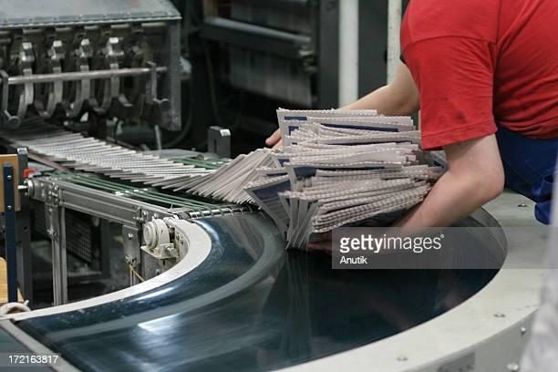 conveyor belt with newspapers