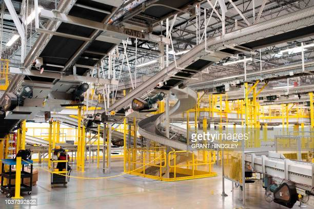 Conveyor belts and slides for incoming goods criss cross during a tour of Amazon's Fulfillment Center September 21 2018 in Kent Washington