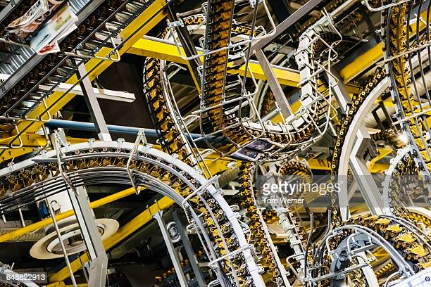 conveyor belts for newspapers in a printery - publisher stock pictures, royalty-free photos & images